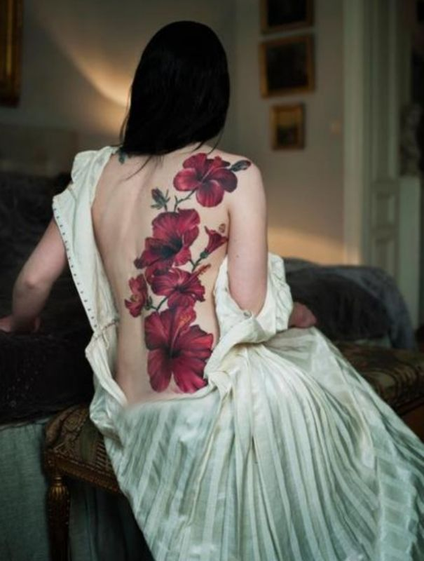 red flowers back tattoos
