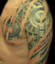 biomechanical slave tattoo