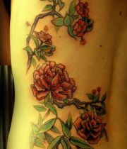 red roses ribs tattoos