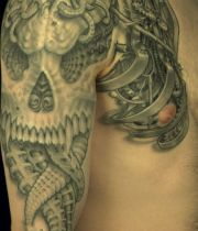 tattoo arm skull biomechanical