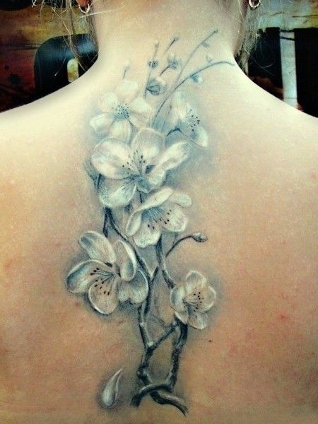 white flowers tattoos on back